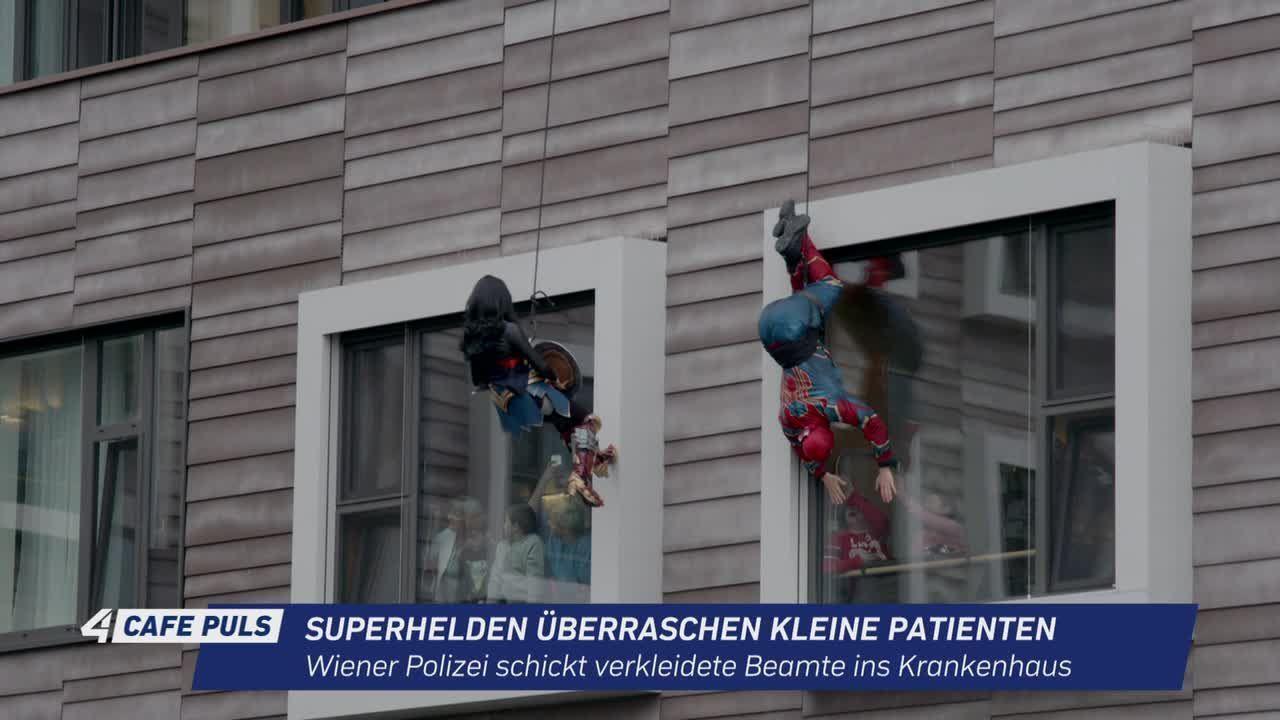 Superhelden überraschen kleine Patienten